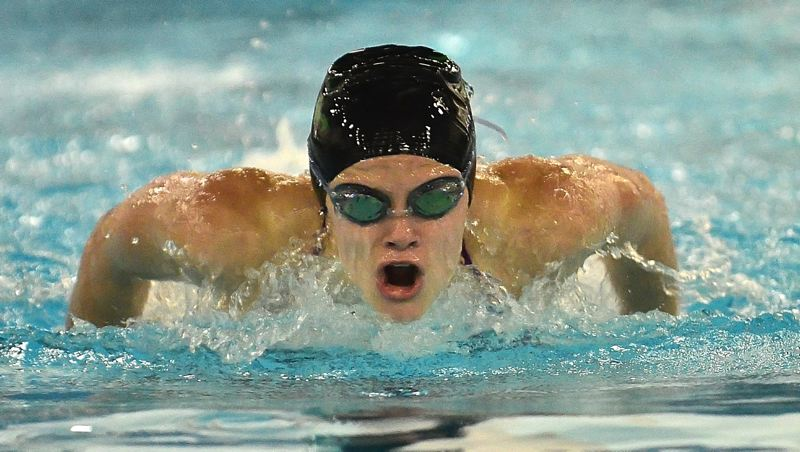 by: VERN UYETAKE - Brie Balsbough takes a breath en route to her victory in the 100 butterfly against Lakeridge last week.