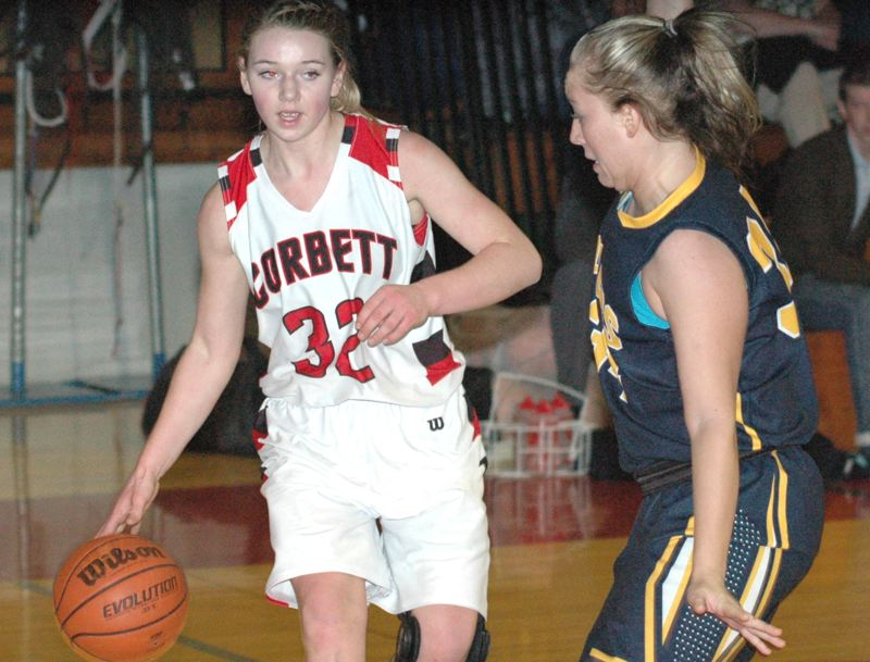 by: THE OUTLOOK: PARKER LEE - Corbetts Elizabeth Wynne dribbles past a Portland Adventist defender during Tuesday nights two-point win that kept the Cardinals alone in second place in the Lewis & Clark League standings.