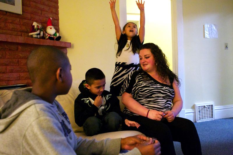 by: PAMPLIN MEDIA GROUP PHOTO: JAIME VALDEZ  - Cally Lamothe, right, sits with her children, Ethan, center, and Zoe, as well as their friend, Daiqwan, left. They live at Tigard's Good Neighbor Center.