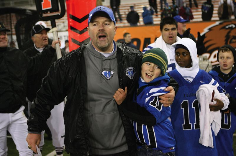 by: PHOTO COURTESY OF KEN INGRAM - Former Hillsboro High football coach Ken Ingram celebrates after the Spartans won the OSAA Class 5A state championship in 2009.