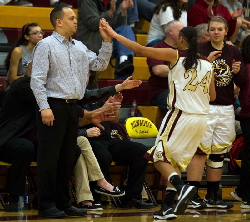 by: JONATHAN HOUSE - Milwaukie coach Kevin McElroy gives Taylor Cunningham (24) the high five as Cunningham exits the floor during last Fridays game with Parkrose. Riding a 12-game win string, the Mustangs are fast proving themselves among the top Class 5A high school girls basketball teams in the state.