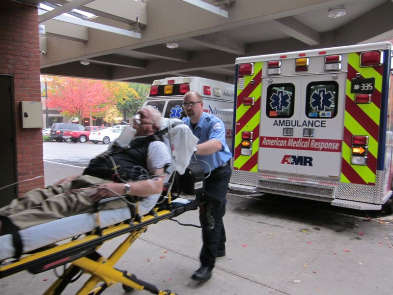 by: PHOTO COURTESY: AMR - American Medical Response paramedic Michael Templeton brings a patient to Good Samaritan Medical Center's emergency room in Portland.