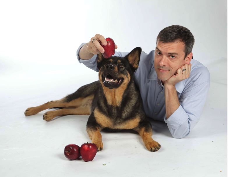 by: PHOTO BY ALICIA DICKERSON GRIFFITH/FOUR LEGGED FRIEND - Rick Woodford, author of 'Feed Your Best Friend Better' will lead off the Ledding Cultural Forum on Feb. 7. He is pictured offering an apple to Raleigh, one of his dogs.