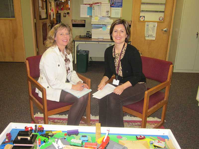 by: BARBARA SHERMAN - HELPING OUT -- Sitting in the Sherwood School District's SHARE Center are Karen Dalbey (left), director of special programs, and Anne Carlson, the center's coordinator and homeless liaison, who work together to serve homeless students in the district.