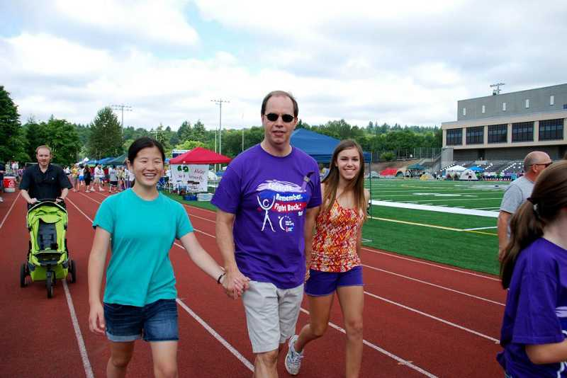 by: SUBMITTED PHOTO: SHARI MACE OLSEN - From left, Anna Hicks, Steve Olsen and Kaity Olsen, from team Eye on the Prize, put in their time during the Relay for Life 2012.