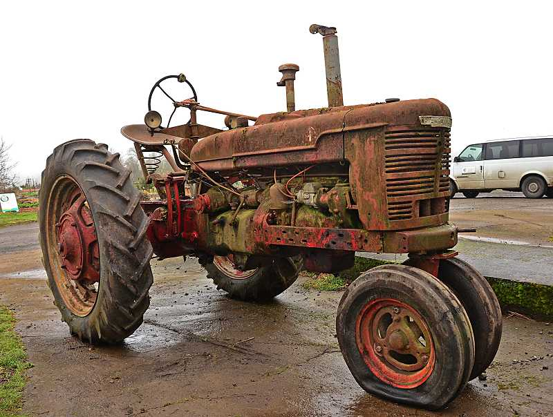 by: REVIEW, TIDINGS PHOTO: VERN UYETAKE - This Farmall H model tractor is grungy now, but it will be a thing of beauty when restored. It will be a major attraction at Luscher Farm.