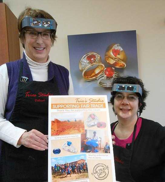 by: REVIEW PHOTO: CLIFF NEWELL - Deborah Spencer, left, and Mary Wong take every opportunity to promote Fair Trade Gems at Trios Studios in Lake Oswego.