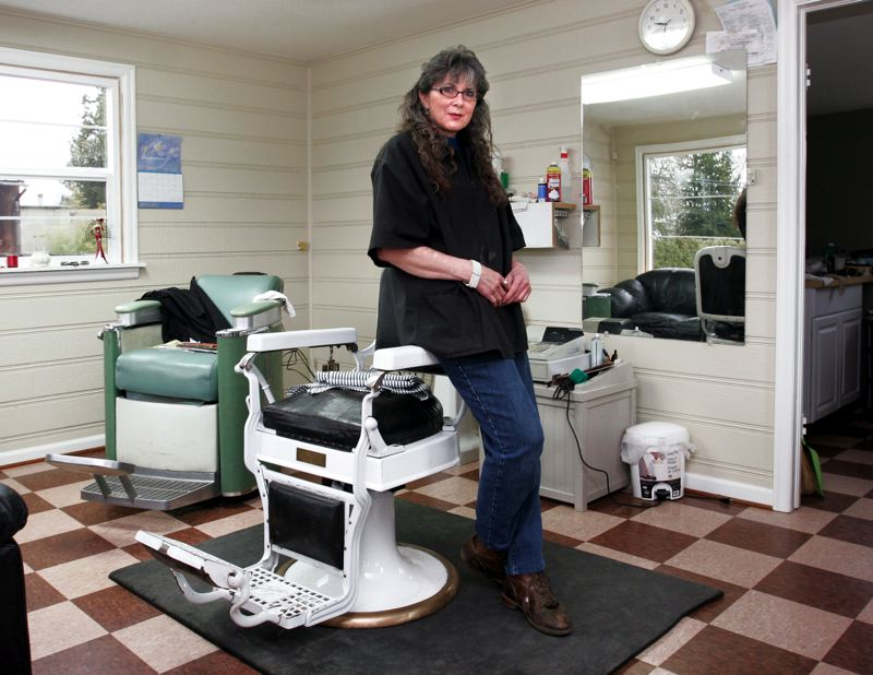 by: OUTLOOK PHOTO: JIM CLARK - After taking a break for her health, Gloria Jonson has reopened her barber shop on Southeast Orient Drive.