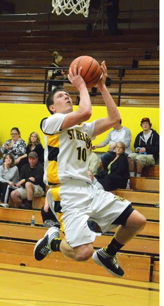 by: JOHN BREWINGTON - St. Helens' Tanner Long has stepped up as the offensive leader for the Lions. He scored 25 points against Sandy on Friday and had 18 against Rex Putnam.
