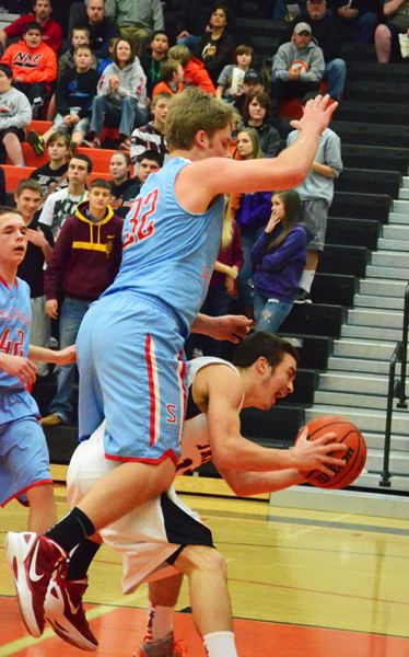 by: JOHN BREWINGTON - Scappoose's Paul Revis has Seaside's Kyle Hague on his back during last week's game with the Gulls. Revis recovered and the Indians won 43-40.
