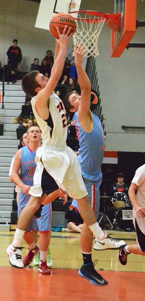 by: JOHN BREWINGTON - Scappoose's Kyle Kramer goes up for a shot during last week's game with Seaside.