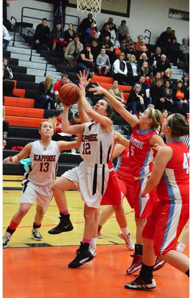by: JOHN BREWINGTON - Scappoose's Abby Kessi goes up for a shot during last week's game with Seaside.