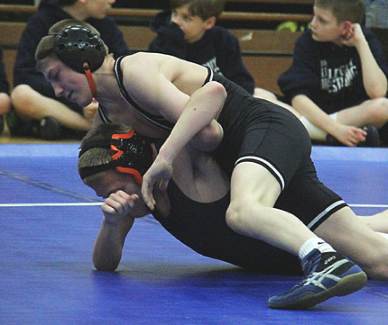 by: JOHN BREWINGTON - Scappoose's Kurt Mode had a good week. He won both matches against Banks and Yamhill-Carlton in a double dual and then won the Hood River Elks Invitational over the weekend.