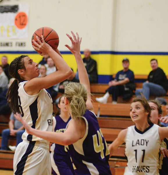 by: CHASE ALLGOOD - Banks senior Samantha Duyck shoots a jump shot over Astoria's Kiera Olson during last Tuesday's Cowapa League girls basketball game.