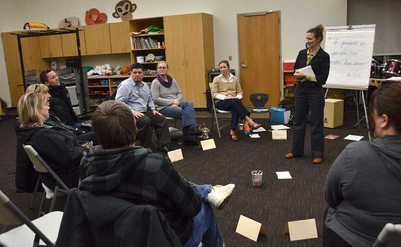 by: VERN UYETAKE  - Parenting instructor April Holt-Geiger leads the class discussion.