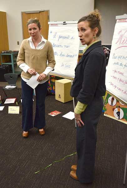 by: VERN UYETAKE  - Parenting instructors April Holt-Geiger, right, and India de Kanter demonstrate how to change perpective when there is a line to be crossed.