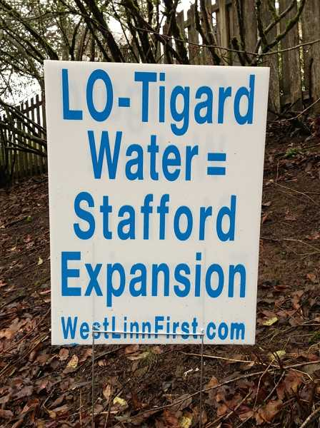 by: LORI HALL -  Signs opposing  a proposed water treatment plant expansion have cropped up all over West Linn.