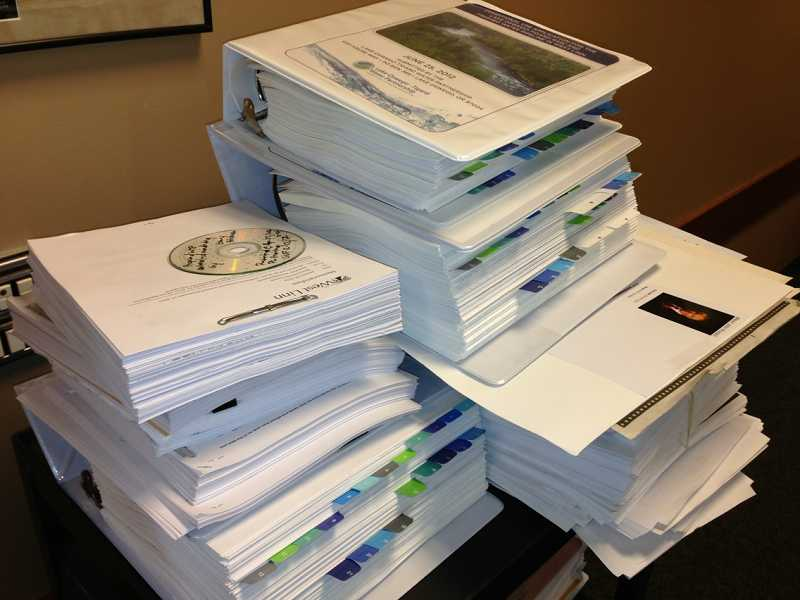 by: LORI HALL - Documents associated with the water treatment plant and pipeline conditional use permit applications are several feet thick.