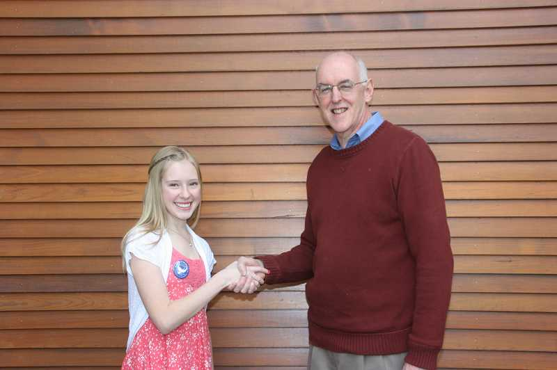 by: SUBMITTED PHOTO - Sam Ward, who won last year's Rotary 4Way Test speech contest, was congratulated by contest chair Rob LeChevallier after the competition.