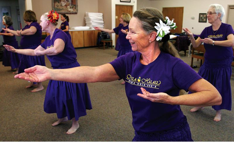 by: PHOTOS: JIM CLARK/PAMPLIN MEDIA GROUP - Lani Harris of Beaverton (right foreground), a student in Lisa Chang's hula dance class for ages 55 and older, took her first hula class in the summer of 2009 and started 'full bore' in the spring of 2010, she says. The class meets Thursday mornings at Light of Life Lutheran Church in Aloha.