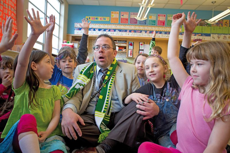 by: TRIBUNE PHOTO: CHRISTOPHER ONSTOTT - Chief Joseph School Principal Joe Galati hams it up with students during a visit to a crowded second-grade classroom.