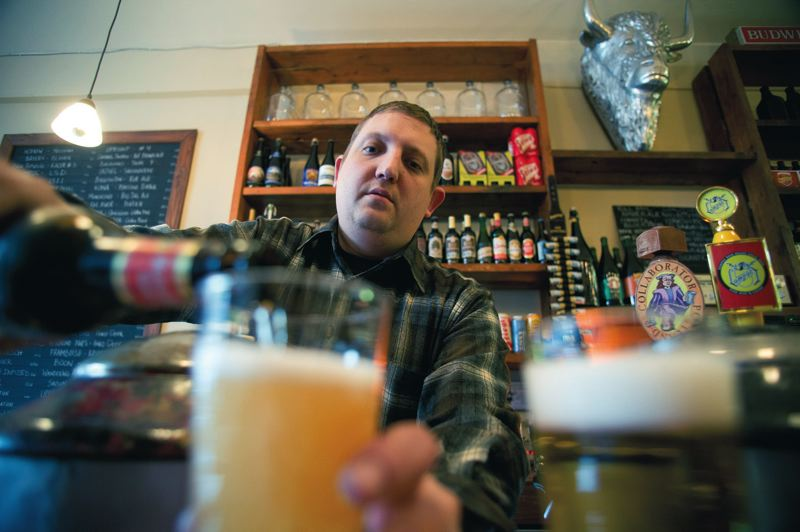 by: TRIBUNE PHOTO: CHRISTOPHER ONSTOTT - Powerful brews and woodsy appeal are the thing at aptly named Beer on Southeast Stark Street, where owner John Stewart works up one of the beverages.