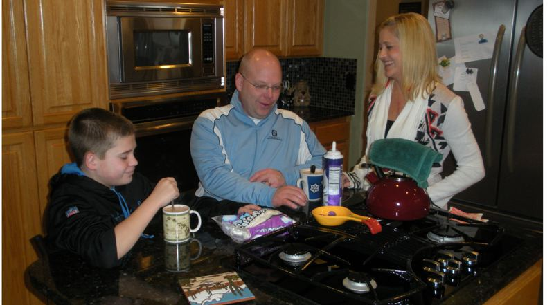 by: POST PHOTO: JIM HART - While Tracy Hoyle serves her family hot chocolate with whipped cream and marshmallows, the trio shares a moment of levity. Even though she is using her second transplanted heart and kidney, Tracys husband, Derrick, says his wife has the worlds most positive attitude.