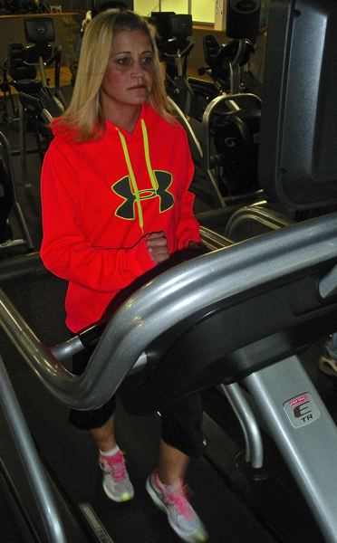 by: POST PHOTO: JIM HART - Tracy Hoyle continues to strengthen her heart, transplanted for the second time late last October, with exercise on a treadmill as part of her active lifestyle.