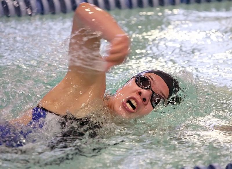 by: MILES VANCE - TOPS IN IM - Aloha's Hannah Vinkemulder races to victory in the 200-yard individual medley during her team's 106-64 win over Beaverton at Beaverton Swim Center on Jan. 24.