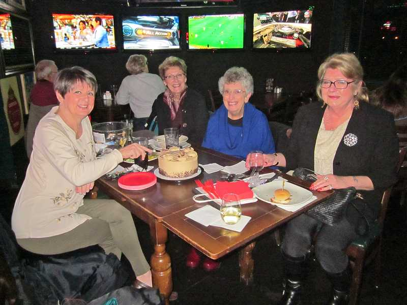 by: BARBARA SHERMAN - TUESDAY NIGHT REGULARS - Jean Duncan (left), Shirley Olbekson, Carol Smith and Ros Daniels along with other Discovery Shop volunteers meet every Tuesday night for happy hour drinks and dinner at J.B. OBriens Pub.