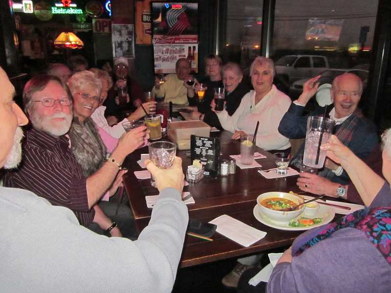 by: BARBARA SHERMAN - TOASTING GOOD FRIENDS - A group that calls itself the Motley Crew, including Donna Grega (third from left), shows up at J.B. OBriens Pub every Friday night for the happy hour specials and takes over one corner of the place.