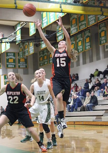 by: MILES VANCE - UP AND OVER - Beaverton's Allison Mueller lofts a shot toward the basket as teammate Dagny McConnell and Jesuit's Sophie Leroux look on during the Beavers' 47-33 win on Friday night at Jesuit High School.