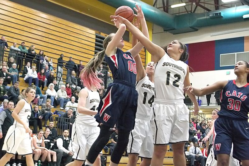 by: MILES VANCE - IN THE KEY - Westview's Dana Bentz gets fouled by Southridge's Tupu Loo during the Wildcats' 55-45 win over the Skyhawks at Southridge High School on Jan. 23.