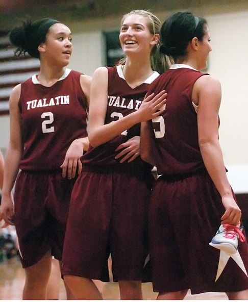 by: DAN BROOD - WINNING SMILES -- Tualatin's (from left) Jasmine Miller, Lindsay Barrow and Baylee Lyle are all smiles near the end of the team's game at Glencoe on Friday. The Wolves pulled away for a 57-40 victory.