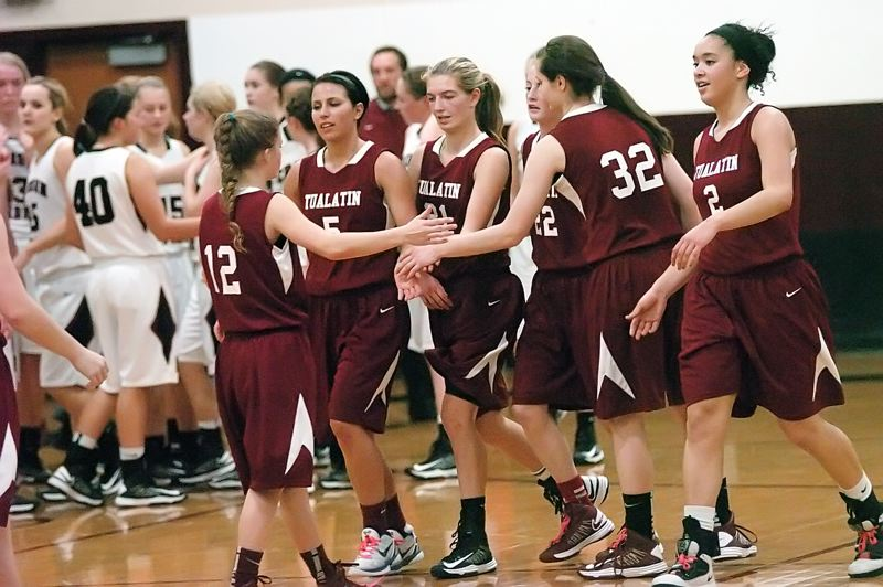 by: DAN BROOD - WE WIN -- Tualatin's (from left) Madison Hall, Baylee Lyle, Lindsay Barrow, Britta Hall, Savannah Heugly and Jasmine Miller gather following the Wolves' win over Glencoe.