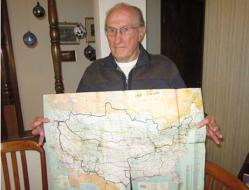 by: BARBARA SHERMAN - GOOD MEMORIES - Bruce holds a map showing all the RV trips he and his wife Betty took around the U.S.