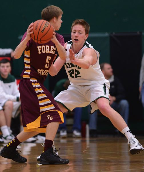 by: BRUCE BERG - TIGER TENACITY -- Tigard High School junior Nathanael Ditton (right) plays tight defense against Forest Grove's Matt Duyck during Friday's game. The Tigers got a 70-53 victory.