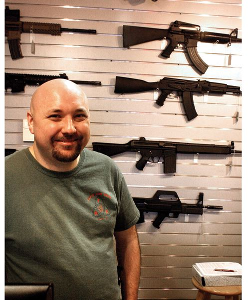 by: SANDY PHOTO PHOTO: SEAN HIGGINS - POST PHOTO: SEAN HIGGINS Rapid Fire Arms owner Brian Coleman says his inventory is disappearing off the walls of his Sandy store.