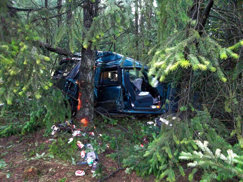by: CONTRIBUTED PHOTO: OREGON STATE POLICE - The mangled wreckage of a Rhododendron womans SUV rests against trees in a wooded area alongside Highway 26, west of Sandy.