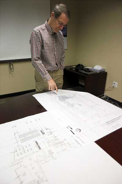 by: TIMES PHOTO: JONATHAN HOUSE - David Vernier, chief executive officer of Vernier Software, goes over renderings of his company's future building expansion.