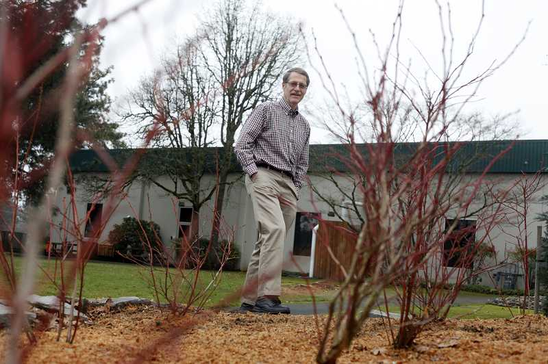 by: TIMES PHOTO: JONATHAN HOUSE - David Vernier, chief executive officer of Vernier Software, stands on property that will be part of the Beaverton company's expansion.