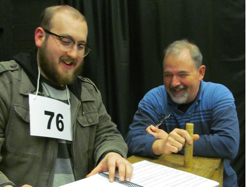 by: PHOTO BY DICK TRTEK - Jon Quesenberry, musical director, and Ron Palmblad, director, look over some sheet music from 'The 25th Annual Putnam County Spelling Bee.'