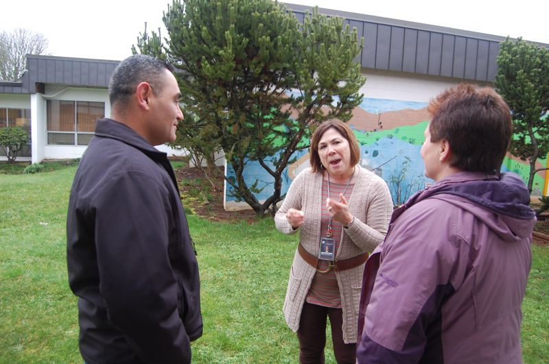by: PHOTO BY: RAYMOND RENDLEMAN - Matthew Magana, whose son is in third grade at Redland Elementary, discusses his courtyard design with Principal Cindy Fillis (center) and PTA President Carol Drudis during last week's tour of the site.