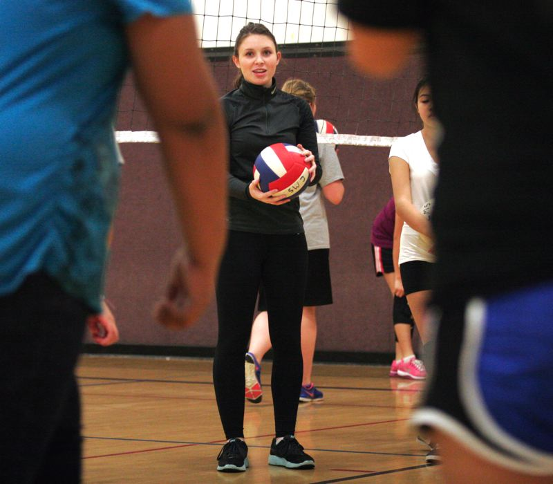 by: OUTLOOK PHOTO: JIM CLARK - Twice a week, Mackenzie Olson volunteers as a volleyball coach with the SUN Program at Centennial Middle School. Being involved in a club or athletic team, she says, is fun and also teaches teamwork and responsibility.