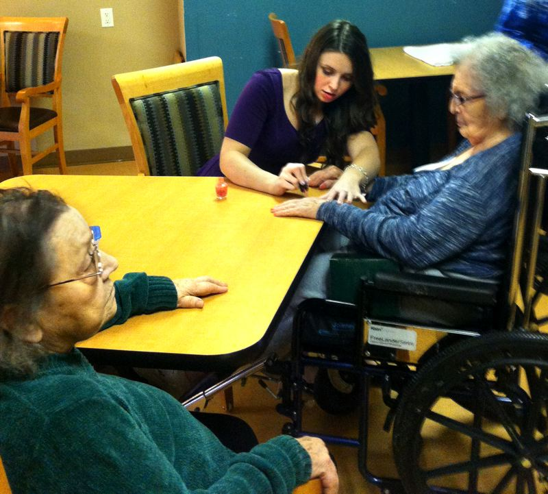 by: CONTRIBUTED PHOTO - Mackenzie Olson has volunteered in the memory unit at Marquis Care of Oregon City for eight years. It's rewarding, she says, to pamper residents with simple pleasures like painting their fingernails or helping with their make-up.