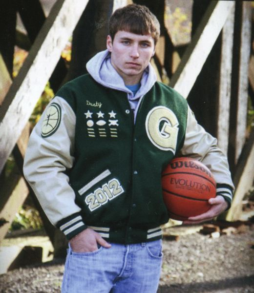 by: COURTESY PHOTO - Dusty Brown sports his lettermans jacket in his senior photo in last years yearbook.