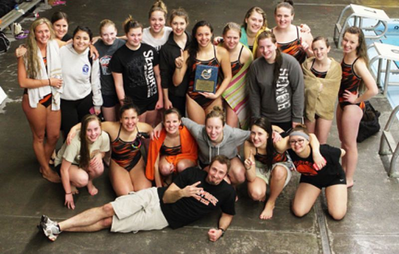 by: KEVIN ALVAREZ - The Scappoose High girls' swim team edged Tillamook on Friday to capture their fourth straight Cowapa League championship. The guy in front holding up four fingers is actually Coach David Richmond.
