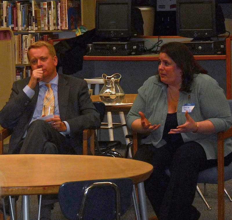 by: DREW DAKESSIAN - State Reps. Julie Parrish and Chris Garrett discuss education funding at a town hall meeting.