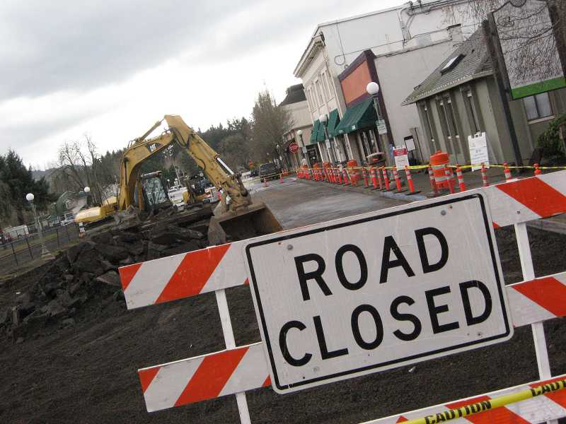 by: RAY PITZ - Railroad Street is now closed between Pine and Washington streets as a major resurfacing project begins. The asphalt is being removed, replaced with concrete.