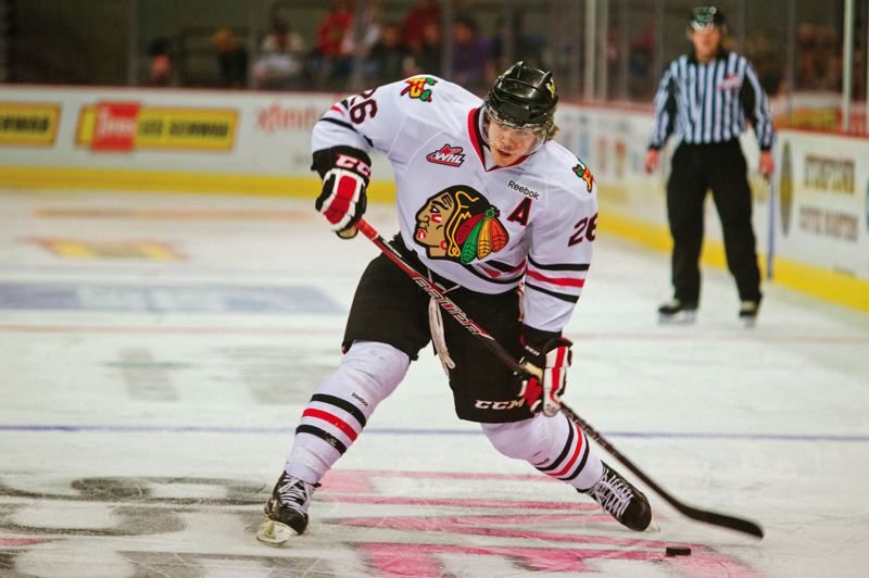 by: TRIBUNE PHOTO: CHRISTOPHER ONSTOTT - Tyler Wotherspoon of the Portland Winterhawks unloads a shot during a game at Memorial Coliseum. He is part of a solid defensive line corps that has performed well offensively, too.